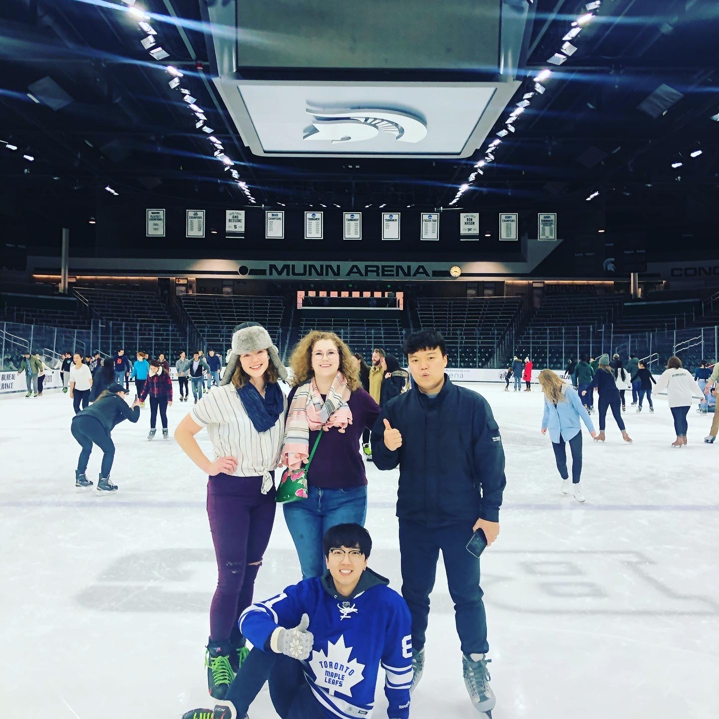 Jin Lee with other graduate students at Munn Arena